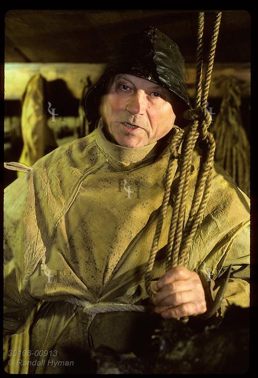 Curator Geir Gudmundsson wears old fisherman's garb in Osver maritime museum; (v) Bolungarvik Iceland