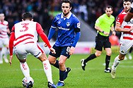Jose Baxter of Oldham Athletic (8) takes on Danny Andrew of Doncaster Rovers (3) during the The FA Cup fourth round match between Doncaster Rovers and Oldham Athletic at the Keepmoat Stadium, Doncaster, England on 26 January 2019.