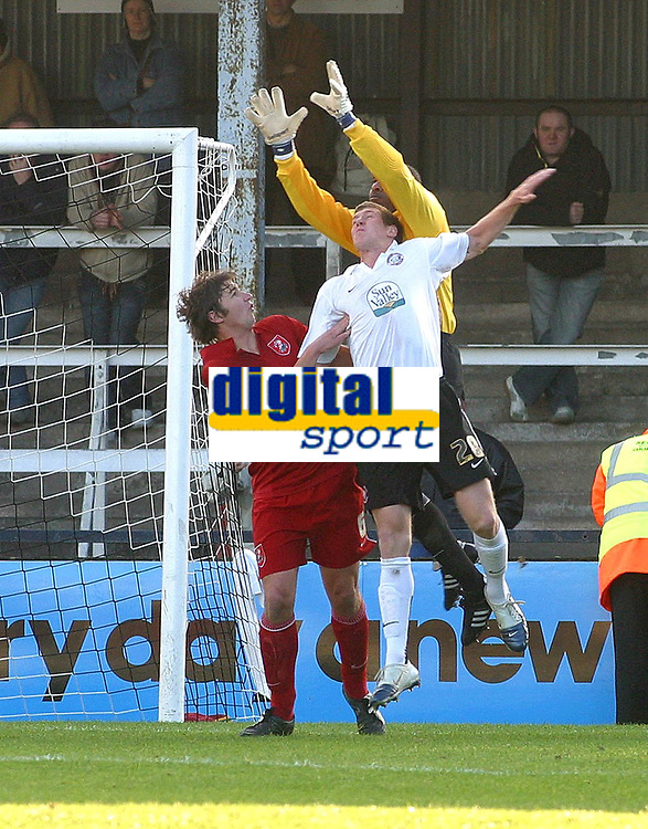 Photo: Dave Linney.<br />Hereford United v Walsall. Coca Cola League 2. 18/11/2006. Walsall keeper Clayton Ince (R) attemps to thwart Alex Jeannin.