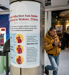 © Licensed to London News Pictures. 24/01/2020. London, UK. Signs have been installed at Heathrow T4 warning passengers of the symptoms of the new Wuhan coronavirus outbreak. The coronavirus virus has infected more than 800 people across Asia in the past few weeks Photo credit: Alex Lentati/LNP