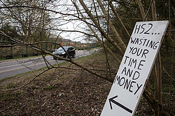 Wendover, UK. 9th April, 2021. A sign outside Wendover Active Resistance Camp, which is occupied by activists opposed to the HS2 high-speed rail link, refers to tree felling works being carried out by HS2 contractors on 9th April 2021 in Wendover, United Kingdom. Tree felling work for the project is now taking place at several locations between Great Missenden and Wendover in the Chilterns AONB, including at Jones Hill Wood.