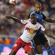 Bradley Wright-Phillips, (left), New York Red Bulls, is challenged by Víctor Bernárdez, San Jose Earthquakes, during the New York Red Bulls Vs San Jose Earthquakes, Major League Soccer regular season match at Red Bull Arena, Harrison, New Jersey. USA. 19th July 2014. Photo Tim Clayton