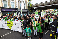 London, UK. 14th June, 2018. Members of the Grenfell community and supporters take part in the Grenfell Silent March through West Kensington on the first anniversary of the Grenfell Tower fire. 72 people died in the Grenfell Tower fire and over 70 were injured.