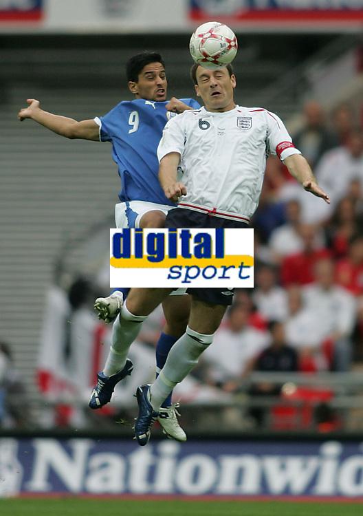 Photo: Lee Earle.<br /> England v Israel. UEFA European Championships Qualifying. 08/09/2007.England's John Terry (R) clashes with Barak Itzhaki.