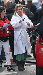 © Licensed to London News Pictures. 12/10/2015. London, UK. Actress Renee Zellwegger wears a bath robe over her costume as she rehearses a scene in the movie Bridget Jones Diary in Borough Market. Photo credit: Peter Macdiarmid/LNP