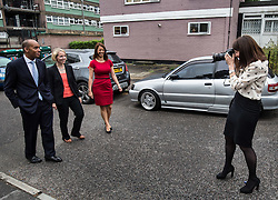 © Licensed to London News Pictures. 20/07/2015. London, UK. Labour leadership contender Liz Kendall (right) photographs Chuka Umunna, Emma Reynolds and Gloria De Piero at Roupell Park Estate in Brixton after borrowing PA photographer Stefan Rousseau's camera. Photo credit : James Gourley/LNP