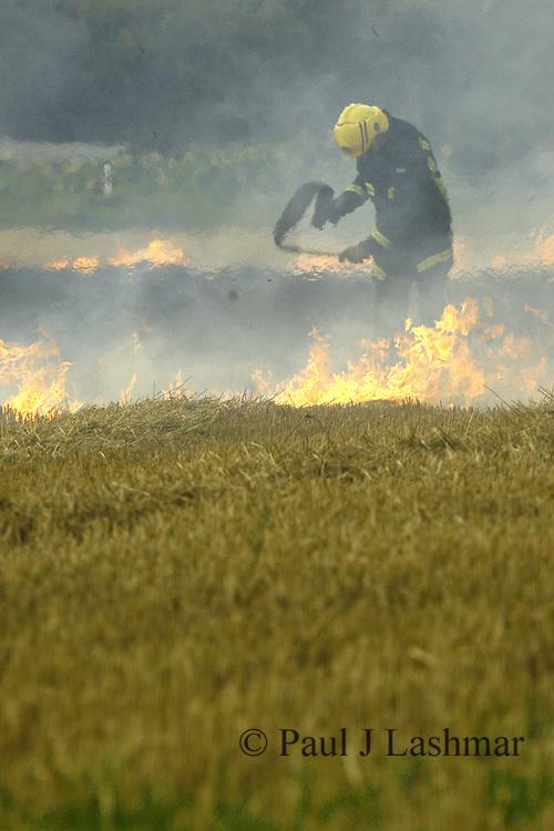 firefighters tackle a stubble fire in fields near the village of Barton Seagrave, Northamptonshire.<br /> summer 2008