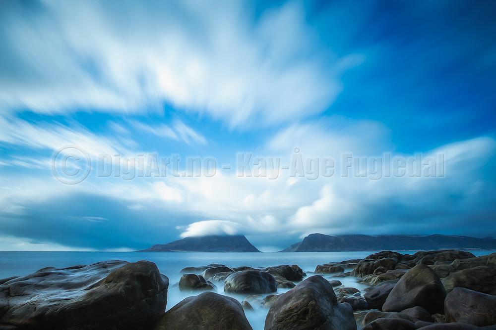 Dreamclouds at seashore, with Skorpesundet, Norway in the background | Drømmeskyer i vannkanten, med Skorpesundet, Norge i bakgrunnen.