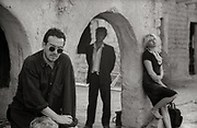 Photograph of Elvis Costello, Joe Strummer and Cortney Love on the set of Straight to Hell - Almeria Spain 1986