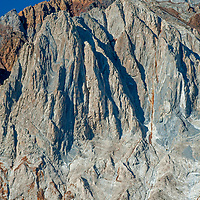 Dramatic erosion has carved deep gullies and steep aretes and ridges on the folded, sedimentary East Face of Laurel Mountain in the eastern Sierra Nevada near Mammoth Lakes.
