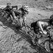L-R Jade, Heather and Micah Goodrich ride bikes along the bike fence near Fruita Colorado.