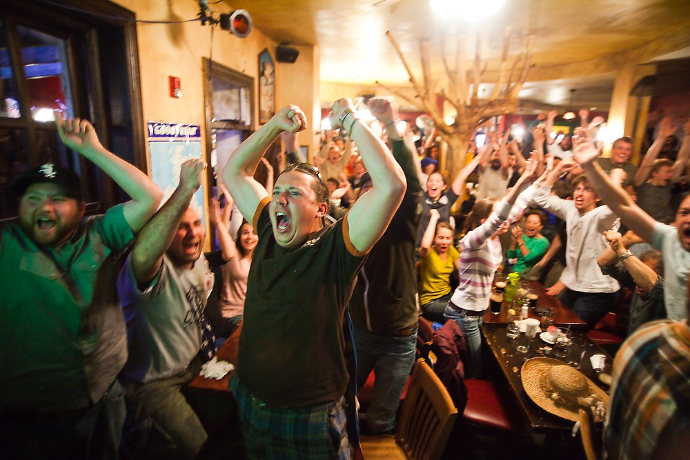 Nick Hess (front) and others at Conor O'Neill's pub in Boulder, Colorado jump for joy as Clint Dempsey scores a goal for the US during the World Cup soccer match between England and the USA on June 12, 2010. The match ended in a 1-1 tie.