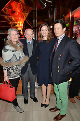 Motor racing legend JOHN SURTEES and his wife JANE SURTEES with their daughter EDWINA SURTEES and BEN RUTT at the launch of the new Ferrari 488 Spider held at Watches of Switzerland, 155 Regent Street, London on 25th February 2016.