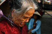 Hoi An, Vietnam. March 14th 2007..An old woman in the market of Hoi An.