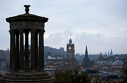 © Licensed to London News Pictures. 14/09/2014. Edinburgh, UK. A view of Edinburgh city and the Dugald Stewart Monument, left, from Calton Hill. With only  four days left to decide on the Scottish referendum, the latest polls give a mixed picture of opinions . Photo credit: Isabel Infantes / LNP