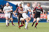 Dorian Jones of the Newport Gwent Dragons (L) tackles Gareth Anscombe  of the Cardiff Blues as he catches the ball. Guinness Pro12 rugby match, Cardiff Blues v Newport Gwent Dragons at the Cardiff Arms Park in Cardiff, South Wales on Sunday 17th April 2016.<br /> pic by Simon Latham, Andrew Orchard sports photography.