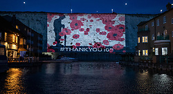 © Licensed to London News Pictures. 08/11/2018. Brighton, UK. A 150 ft image of a WW1 soldier and falling poppies is projected onto the cliff face above Brighton Marina ahead of the Centenary Armistice Commemorations. Called 'Brighton's Biggest Thank You', the projection will run nightly between 4pm-10pm until Sunday 11th November . Photo credit: Peter Macdiarmid/LNP