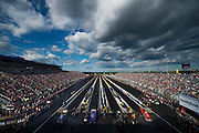 April 22-24, 2016: NHRA 4 Wide Nationals: NHRA top fuel dragsters prepare for an eliminations.