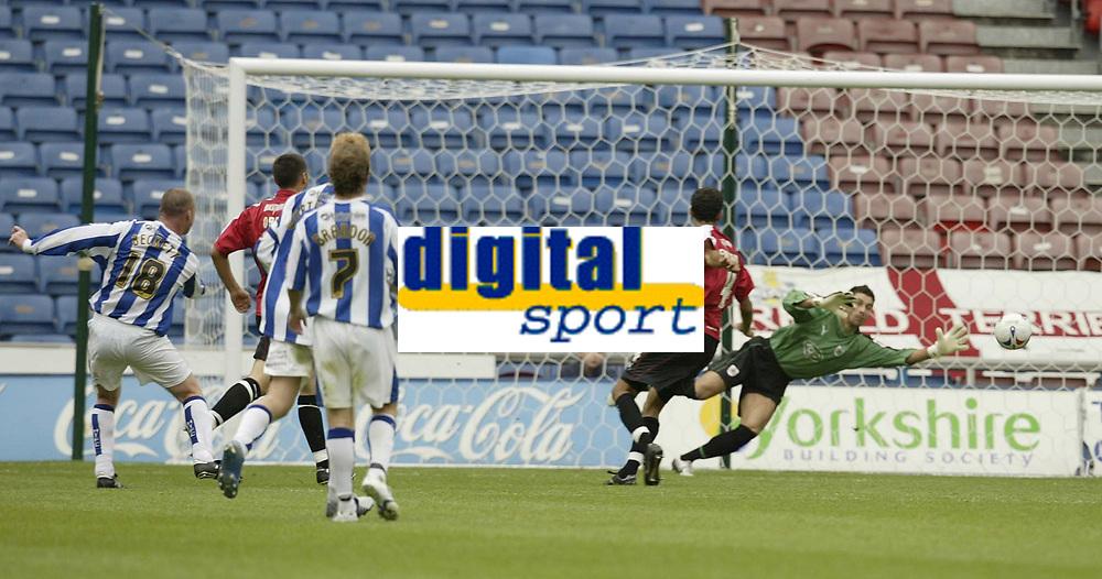 Photo: Aidan Ellis.<br /> Huddersfield Town v Bristol City. Coca Cola League 1. 12/08/2006.<br /> Huddersfield's Luke Beckett scores the equaliser