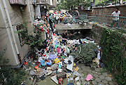 "QINGDAO, CHINA - SEPTEMBER 09: (CHINA OUT)<br /> Waste Picked Up By An Elder Man Filled House<br /> <br /> Sanitation workers clean the waste dug out from a house in forth storey on September 9, 2015 in Qingdao, Shandong Province of China. Those waste came from an octogenarian who picked up and piled them in his house even smelled heavily bad. Advised many times by residents of the same community, the octogenarian did as usual. Thus his son had to ""cheated"" him out the house on Tuesday so that the property staffs could clean those waste. The clear-up work stared on Tuesday and sanitation workers arrived to help the following day.<br /> ©Exclusivepix Media"