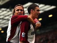 Fotball<br /> Premier League 2004/05<br /> Manchester United v Middlesbrough<br /> 3. oktober 2004<br /> Foto: Digitalsport<br /> NORWAY ONLY<br /> Bolo Zenden hugs goalscorer Stuart Downing