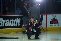 REGINA, SK - MAY 23: Regina Pats' photographer Keith Hersmiller kneels on the ice at the start of the game at the Brandt Centre on May 23, 2018 in Regina, Canada. (Photo by Marissa Baecker/CHL Images)