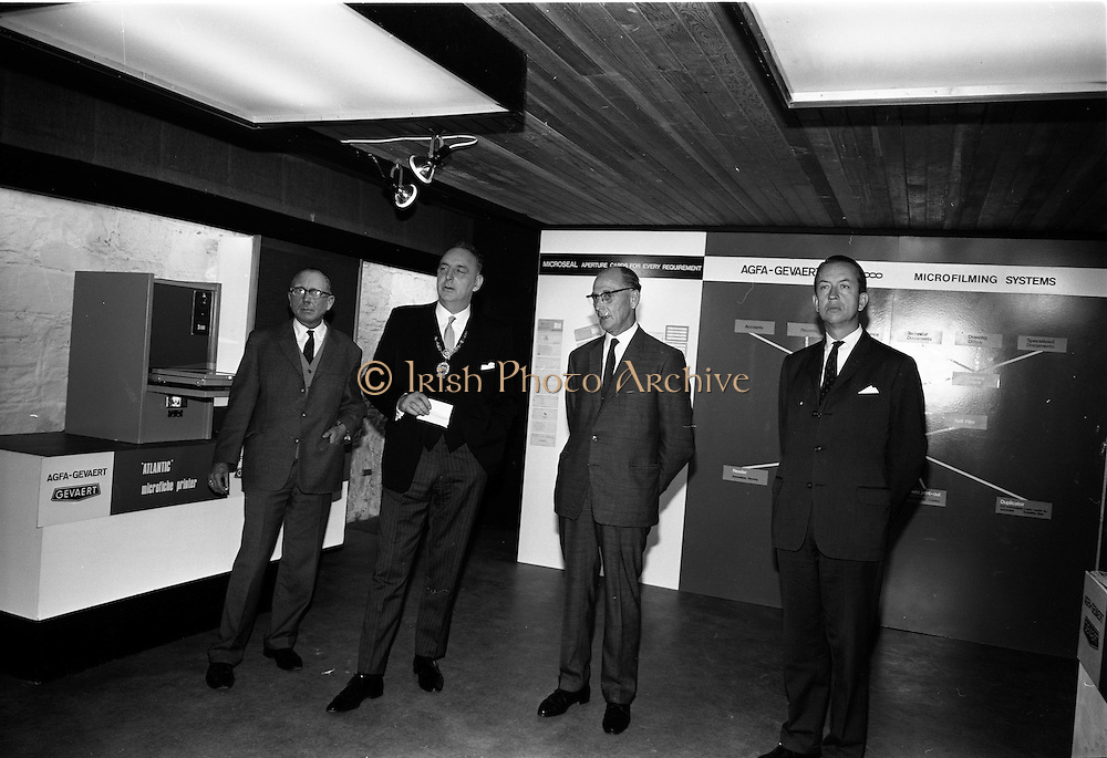 """119/09/1967<br /> 09/19/1967<br /> 19 September 1967<br /> Opening of Agfa-Gevaert exhibition at the Building Centre, Lower Baggot Street, Dublin. Exhibition """"Microfilms in the Space Age"""" demonstrating microfilming equipment and facilities, most of the equipment was exclusive to Agfa-Gevaert Limited. Pictured (l-r) are: Mr Heinrich Toebelman, Commercial Councillor of the (West) German Embassy; The Lord Mayor of Dublin, Alderman Tom Stafford; Mr Patrick Howard,General Manager, Agfa-Gevaert Ltd. and M. Baudouin Verhaeren, Charge d'Affaires, Belgian Embassy."""