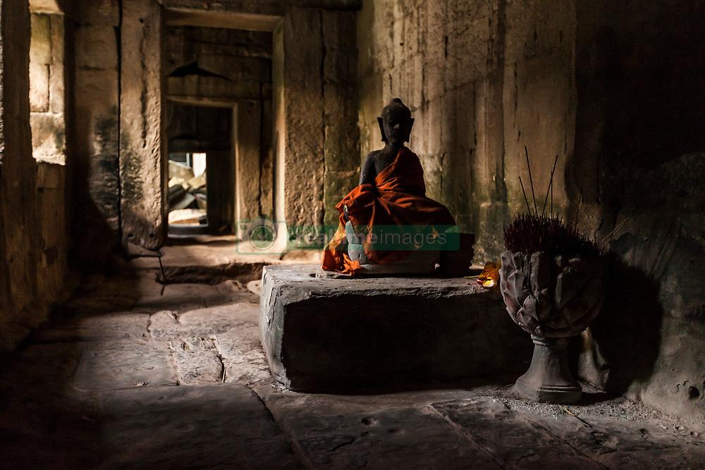 Aug. 2, 2013 - Buddha statue at the Ta Prohm Temple ruins at  Angkor Wat, Siem Reap, Cambodia (Credit Image: © Gary  Latham/Cultura/ZUMAPRESS.com)