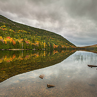 An overcast and calm day provides beautiful autumn reflections at Bubble Pond in Acadia National Park, Maine.