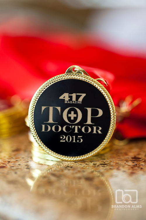 A macro shot of a medal at 417 Magazine's 2015 Top Doctors Event.