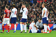 Eric Dier of England being treated for an injury during the UEFA European 2020 Qualifier match between England and Czech Republic at Wembley Stadium, London, England on 22 March 2019.