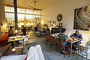 "Guests having breakfast at the basement room at ""Casa das Janelas com Vista"", an hotel in Bairro Alto district, in Lisbon, Portugal."
