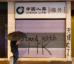 Hong Kong. 6 October 2019. Tens of thousands of pro-democracy protestors march in pouring rain through centre of Hong Kong today from Causeway Bay to Central. Peaceful march later turned violent as a hard-core of protestors confronted police. Pic; Vandalised branch of China Life office in Causeway Bay. Iain Masterton/Alamy Live News.
