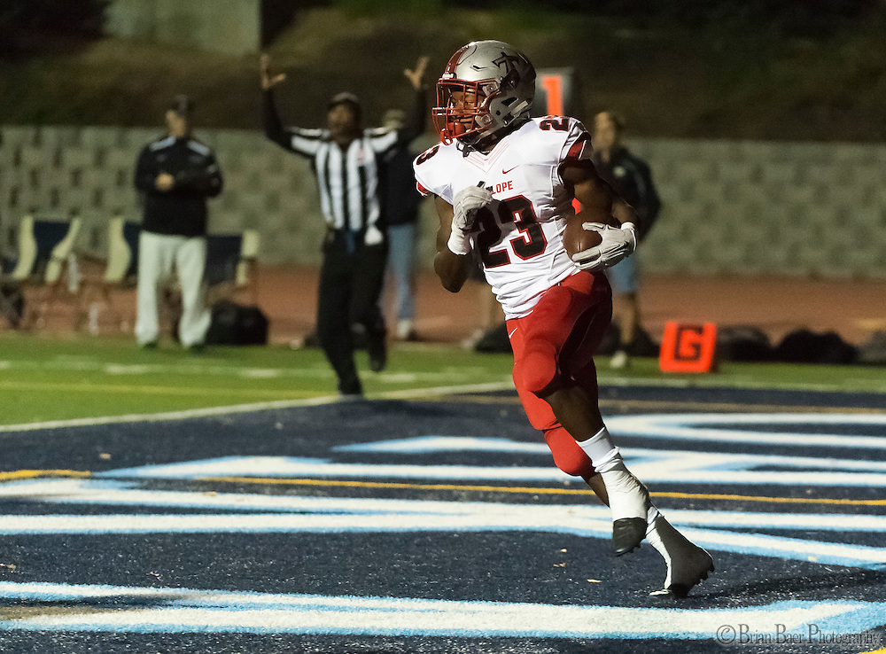 Antelope High School Titans Elijah Dotson (23), backs into the end zone for a touchdown to trail 7-6 after the  missed point after attempt during the second quarter as the Oakmont High School Vikings host the Antelope High School Titans Friday Sep 30, 2016.<br /> photo by Brian Baer