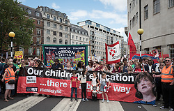 © Licensed to London News Pictures. 05/07/2016. London, UK. Thousands of school teachers, parents and pupils march through central London as teachers go on strike. The strike, called by the National Union of Teachers (NUT), is in response to cuts to funding and issues with workload, pay and other conditions. Photo credit: Rob Pinney/LNP