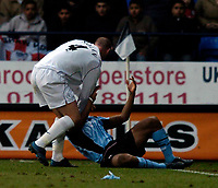 Photo. Jed Wee.<br /> Bolton Wanderers v Fulham, FA Cup 5th Round, 19/02/2005.<br /> Bolton's Kevin Nolan (L) shoves Fulham's Collins John onto the ground as tempers flare.
