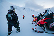 UNIS students listen to instructions during a snowmobile driving and safety training in Adventdalen, Svalbard.
