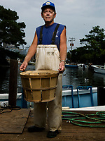 www.shawnrocco.com<br /> www.cellularobscura.com<br /> 919-812-8291<br /> shawnrocco@gmail.com<br /> <br />  Mickey Daniels, 61, has been crabbing the Roanoke Sound since he was seventeen-years-old. Here he is at his dock in Wanchese, North Carolina.