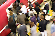 commuters during rush hour entering a train Japan Tokyo