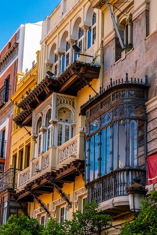 """So called """"Maltese balconies"""", (closed balconies), line Plaza de San Francisco,  the city's main square adjoining City Hall (Ayuntamiento), Seville, Andalusia, Spain."""
