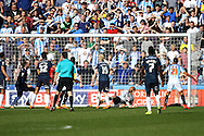 Nahki Wells of Huddersfield Town ® watches the ball go over the goalkeeper as he scores his teams 4th goal. Skybet football league championship match, Huddersfield Town v Derby county at the John Smith's stadium in Huddersfield, Yorkshire on Saturday 18th April 2015.<br /> pic by Chris Stading, Andrew Orchard sports photography.