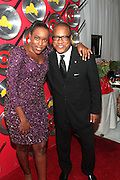 """September 18, 2012- Harlem, New York: (L-R) Trenesse Woods-Black, Sylivia's Restaurant and Greg Cunningham, Senior Group Manager, Strategic Partnerships & Lifestyle Marketing attend Sylvia's Restaurant 50th Anniversary Golden Jubliee Gala celebrating the life and legacy of the late Sylvia Woods and held at Sylvia's Restaurant on September 18, 2012 in the Village of Harlem, USA. The 50th Anniversary Gala salutes Sylvia's as """"the world's kitchen"""" and celebrates a legend of the historic Harlem community. With an invite-only fundraising event for 500+ guests, the night kicked-off with a lavish cocktail hour and live performances from Sylvia's A-list guests, many of whom have made Sylvia's a home away from home for the past 5 decades. (Terrence Jennings)"""