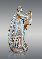 Roman ststue of Apollo with a lyre, copied from an earlier 4th cebtury BC Hellenistic statue, from a group of Muses found in Villa de Cassius at Tivoli,  inv 310, Vatican Museum Rome, Italy,  grey  background ..<br /> <br /> If you prefer to buy from our ALAMY STOCK LIBRARY page at https://www.alamy.com/portfolio/paul-williams-funkystock/greco-roman-sculptures.html . Type -    Vatican    - into LOWER SEARCH WITHIN GALLERY box - Refine search by adding a subject, place, background colour, museum etc.<br /> <br /> Visit our CLASSICAL WORLD HISTORIC SITES PHOTO COLLECTIONS for more photos to download or buy as wall art prints https://funkystock.photoshelter.com/gallery-collection/The-Romans-Art-Artefacts-Antiquities-Historic-Sites-Pictures-Images/C0000r2uLJJo9_s0c
