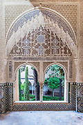 Arched window overlooking the garden. Alhambra Palace, Granada, Spain