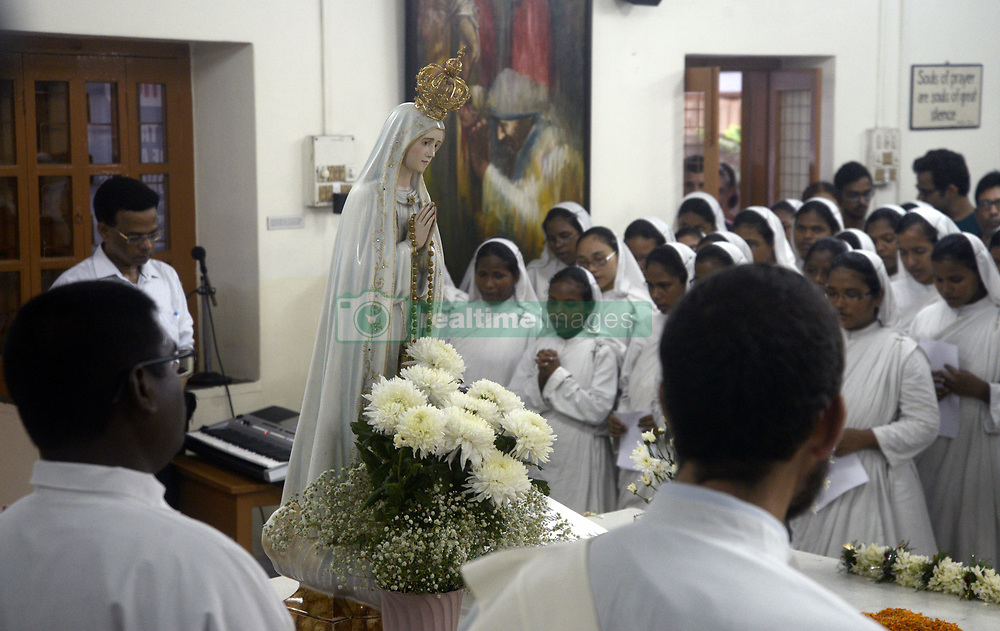 August 26, 2017 - Kolkata, West Bengal, India - Nuns and visitors take part in mass prayers on the occasion of 107th years birth anniversary of Mother Teresa in Kolkata. ndian nuns and catholic devotees take part in a mass prayer during a service celebrating the 107th years birth anniversary of Mother Teresa at the Indian Missionaries of Charity house on August 26, 2017 in Kolkata.  The Nobel peace laureate Mother Teresa was canonized by Pope Francis during a ceremony at the Vatican City on September 04, 2016 and makes her a Catholic Saint Teresa of Calcutta. (Credit Image: © Saikat Paul/Pacific Press via ZUMA Wire)