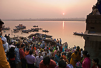 Pilgrims at sunrise on the ghats during the festival of Kartik Poornima in Varanasi, Uttar Pradesh, India