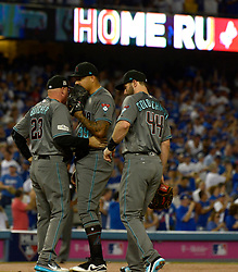 October 6, 2017 - Los Angeles, California, U.S. - Arizona Diamondbacks pitching coach Mike Butcher (23) speaks with starting pitcher Taijuan Walker (99) after giving up a three run home run to Los Angeles Dodgers third baseman Justin Turner (not pictured) in the first inning of a National League Divisional Series baseball game at Dodger Stadium on Friday, Oct. 06, 2017 in Los Angeles. (Photo by Keith Birmingham, Pasadena Star-News/SCNG) (Credit Image: © San Gabriel Valley Tribune via ZUMA Wire)
