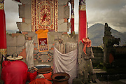 Colorful decorations adore a shrine in Ulun Danu Batur temple. Named after a goddess that rules the water supply, this pura is the second most significant  in Bali and has over 100 shrines overlooking Gugung Batur mountain and Lake Batur bellow. Gugung Batur is an active volcano that last erupted in 1994.