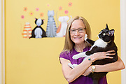 Sara Crutchfield and Abe pose for the banner image of saralovespets dot com, Thursday, Oct. 10, 2019, at her apartment in Louisville, Ky. (Photo by Brian Bohannon)