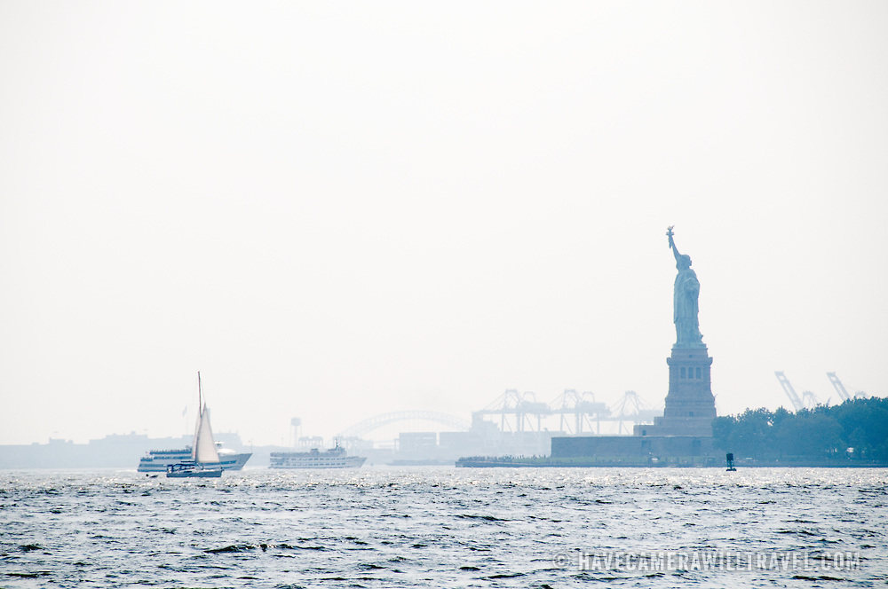 Statue of Liberty in the haze, looking from Battery Park on Manhattan